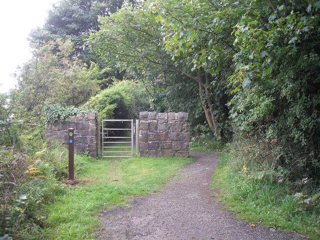 Gate in a wall with the path going round the wall