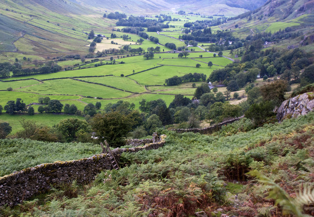 A stile with a view of upper Langdale