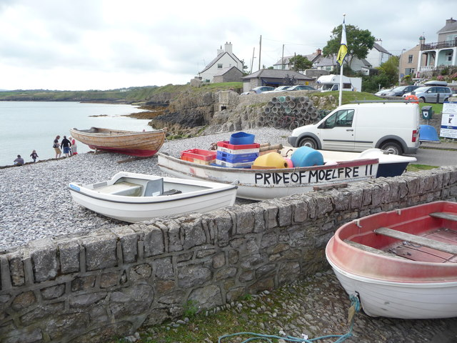Part of the beach and foreshore at Moelfre
