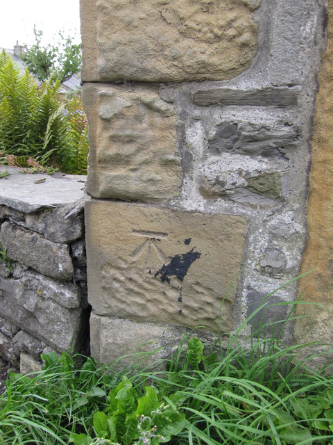 Bench mark alongside Goat Lane