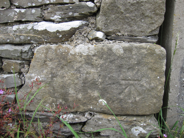 Bench mark on a barn in Goat lane