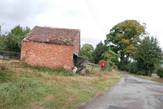 Red Brick Storage Barn on T Junction