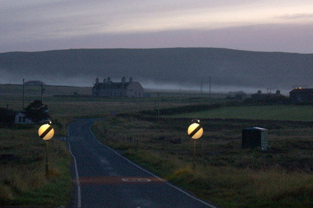 The A968 in Baltasound at dusk