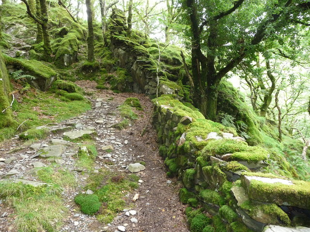 Dry stone wall descends a steep hillside crag