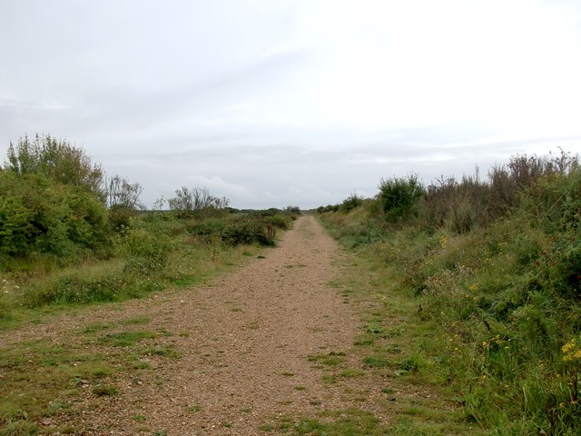 Path behind the seawall, leading to Thorney Island