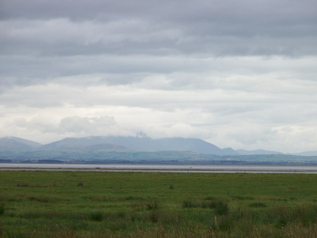 Looking across the Caerlaverock National Nature Reserve towards the mountains of the Lake District