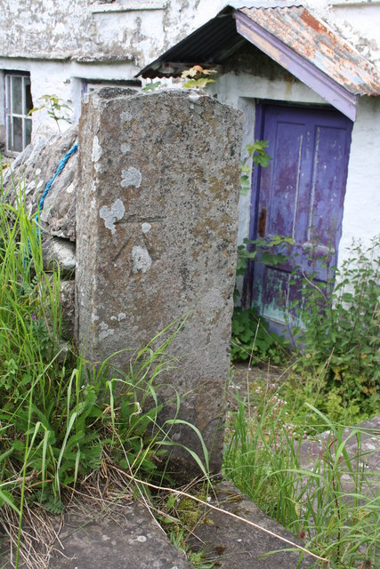 Benchmark on gatepost at entrance to derelict house