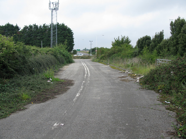 View along the disused section of the old A299