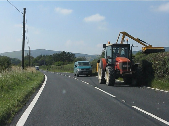 Hedge cutting on the A44 near Downton