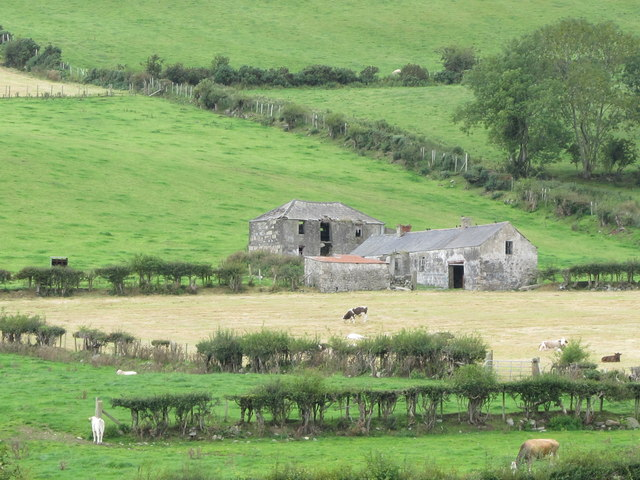 Abandoned farmhouse and farm buildings in the lower Ghann River Valley
