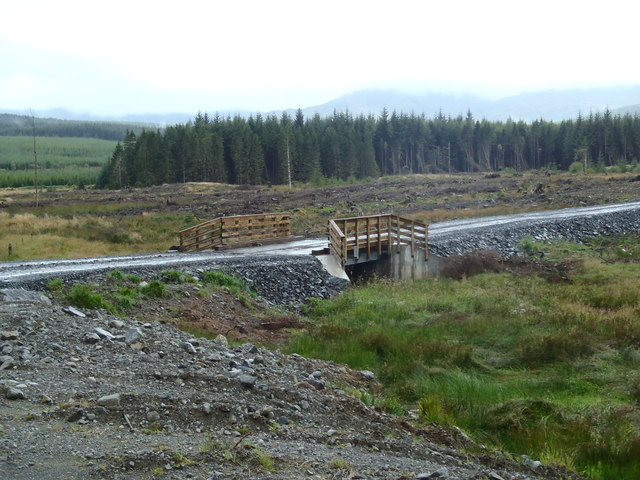 Timber bridge over a tributary of the Polmaddy Burn