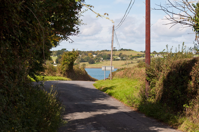 A road leaving Westleigh with a glimpse of the river Torridge