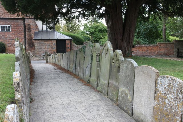 Headstones mark the path