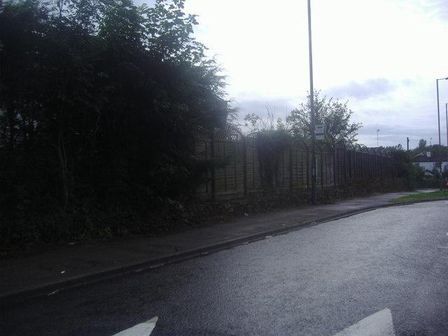 Bus stop on a wet A25, Godstone