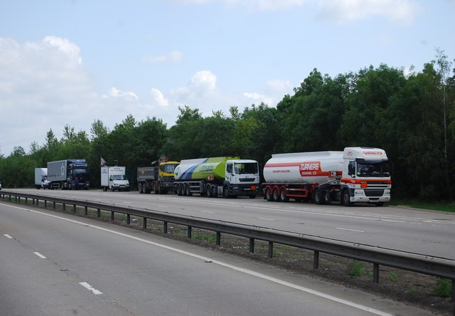 Lorries parked in a layby, A11
