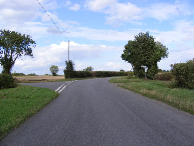 Road junction with the road to Chapel Road