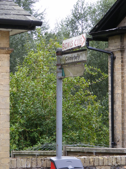 Roadsign to the Cemetery & Bowls Club