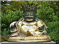 TF6928 : Statue of Buddha in the grounds of Sandringham, Norfolk by pam fray