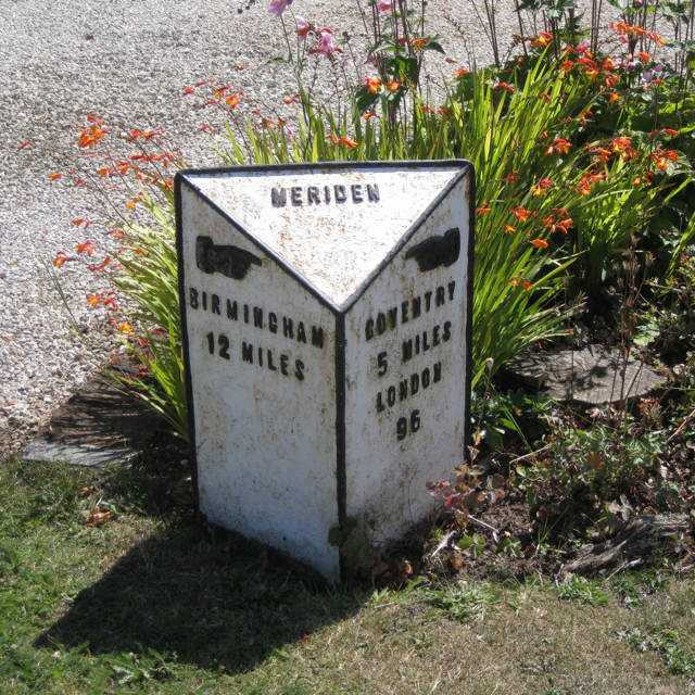 Milestone in a front garden, Main Road