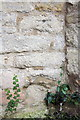 SP4909 : Eroded benchmark on St Peter's Church by Roger Templeman