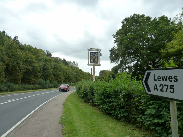 A275 passing the sign for the Five Bells at Chailey