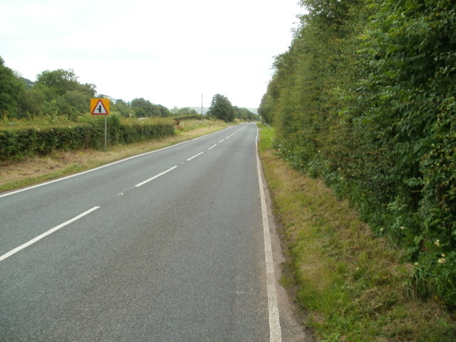 A4067 approaches junction with minor road