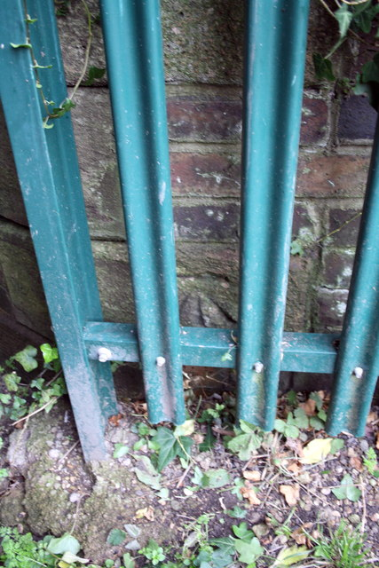 Benchmark behind fence on abutment of bridge 236A