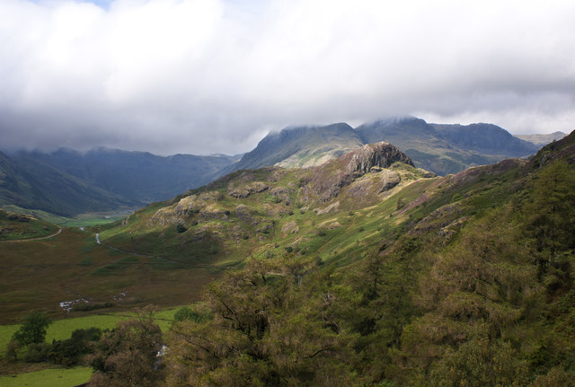 Side Pike and the Langdales can be seen over the trees in the gorge