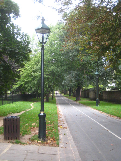 A tree-lined avenue leading to Holland Park from Kensington High Street