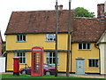 TL8352 : Red Boxes And Cottages by Keith Evans