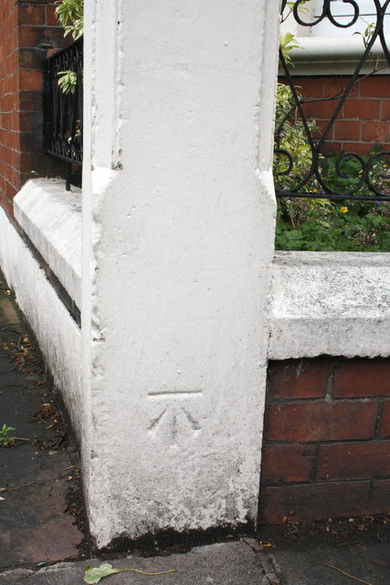 Benchmark on wall corner of #76 Aglionby Road