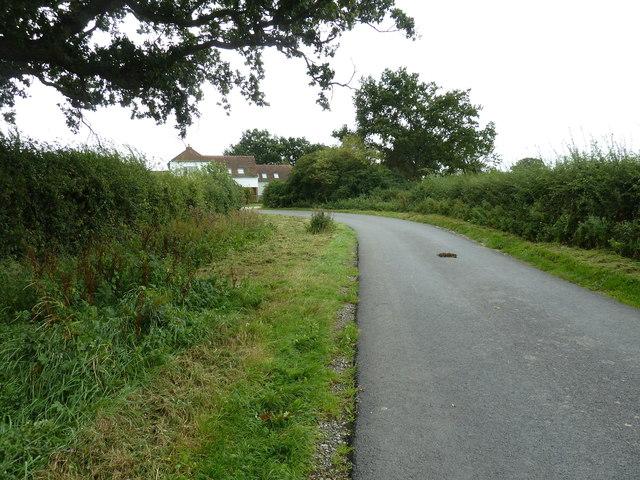 Sharp bend on Highbridge Lane by Bowling Green Cottage