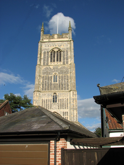 Peeking over the roofs - the tower of All Saints church, Laxfield