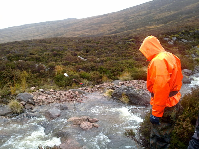 Crossing a burn in spate in the Cairngorms
