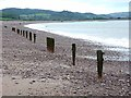 ST0243 : Posts on the beach at Blue Anchor by Oliver Dixon