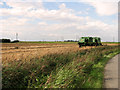 TF6213 : Combine harvesters in field beside Mill Road, Setchey by Evelyn Simak