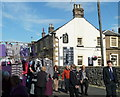 SK2168 : Market stall and pub, Bakewell by Andrew Hill
