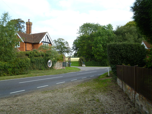 Footpath reaches Smithwood Common Road from the west