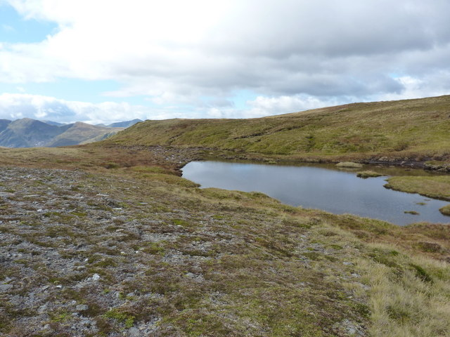 Boggy pool on the bealach to Carn a' Choire Bhuidhe