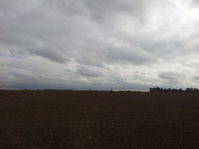 Dairy Farm seen across recently ploughed fields