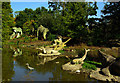 TQ3470 : Heron among dinosaurs, Crystal Palace Park by Julian Osley