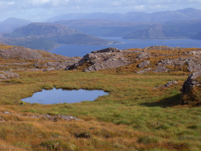 Tiny loch below the summit of Meall Loch Airigh Alasdair near Applecross
