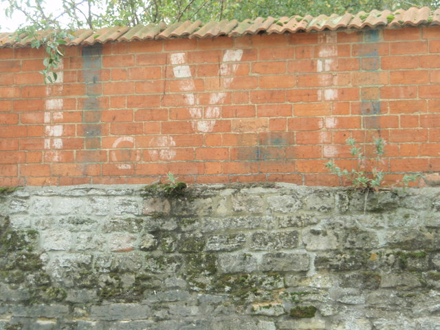 Marks on a wall in Brigstock