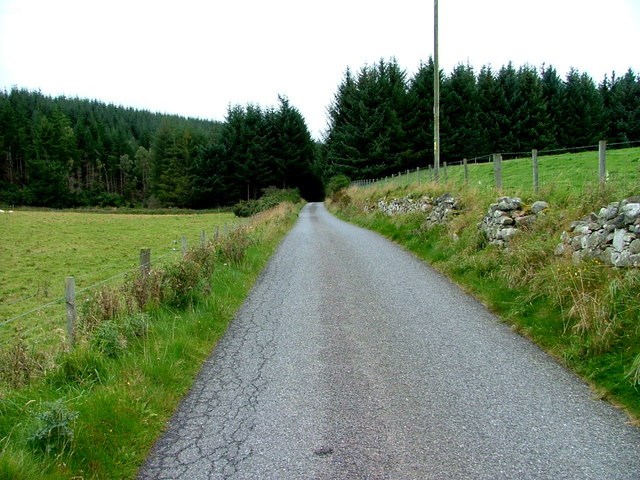 Looking northeast along the minor road at Drummore of Clava
