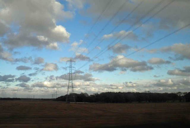 Power lines alongside and crossing the East Coast railway