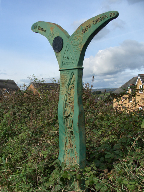 Millennium milepost beside National Cycle Route 4, Kenfig Hill