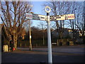 TQ3395 : Fingerpost on the corner of Village Road, Bush Hill Park by David Howard