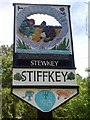 TF9743 : Stiffkey Village Sign by Theo Foster