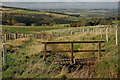 NT6017 : Footbridge below Blacklaw Strip by Jim Barton