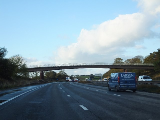 Craddocks Moss Farm and footpath bridge over M6